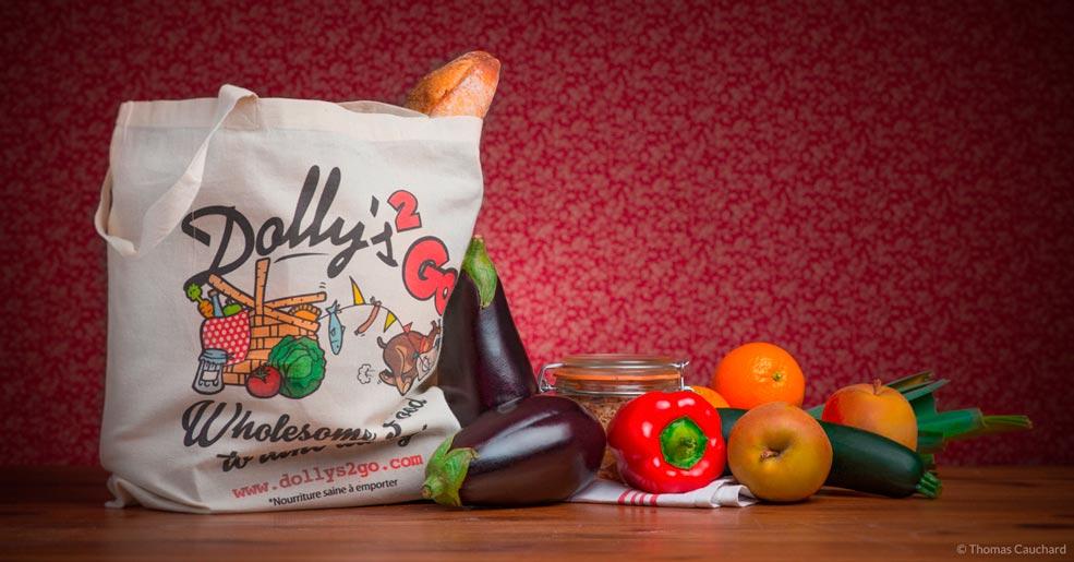 Packshot d'un sac en coton bio pour la vente à emporter avec le logo Dolly's 2 Go